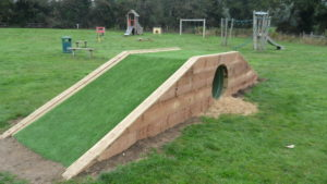 "Refurbished play tunnel at the Meadow's - just need someone to ""mow"" the grass on the top!"